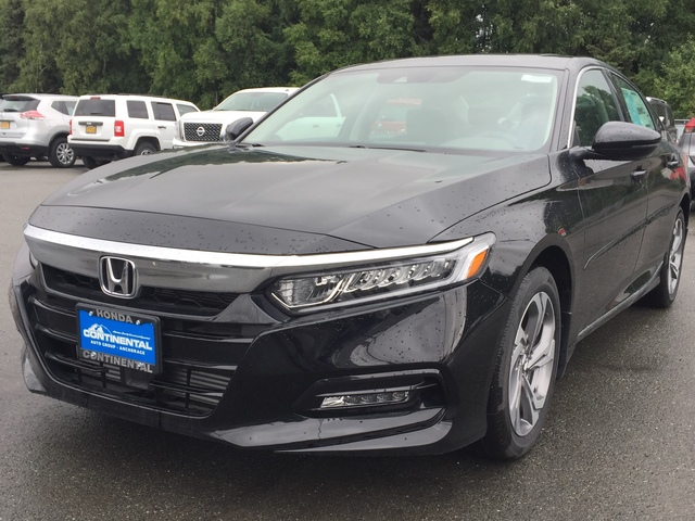 Schedule a test drive in this 2018 {make Accord Sedan
