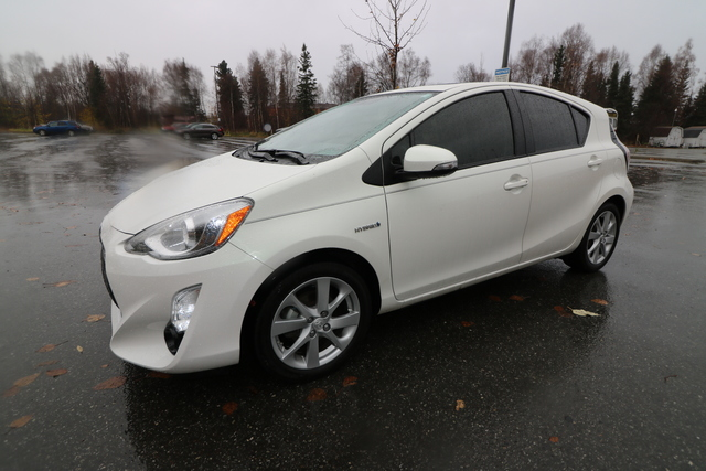 Schedule a test drive in this 2015 {make Prius c